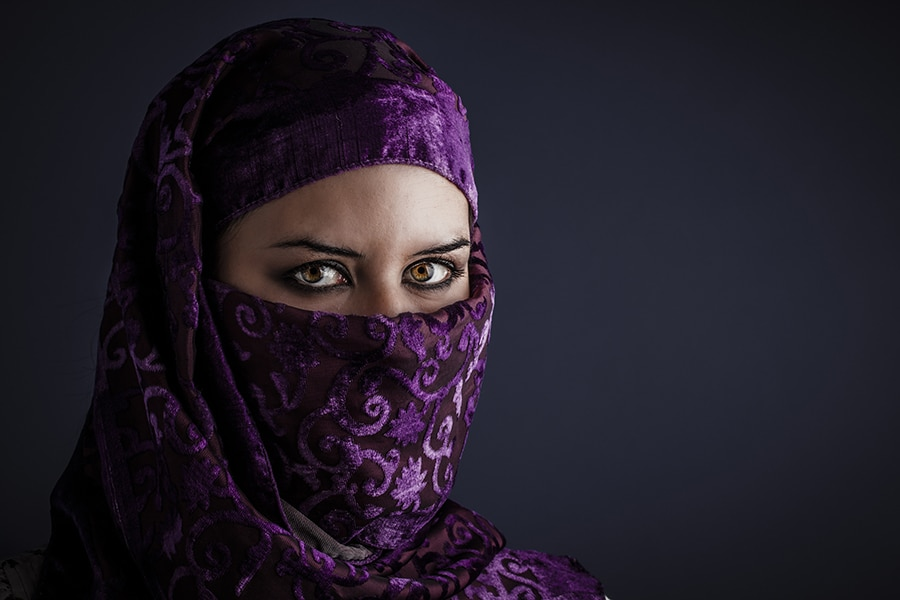 Arab women with traditional veil, eyes intense, mystical beauty
